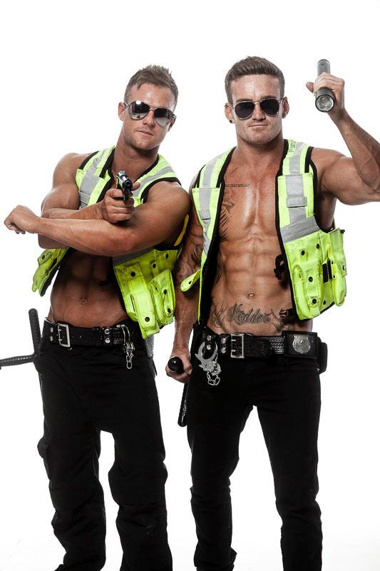 Ken and Matt dressed as policemen