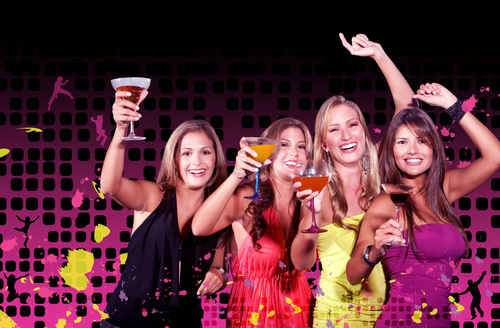 Girls drinking cocktails at hens party