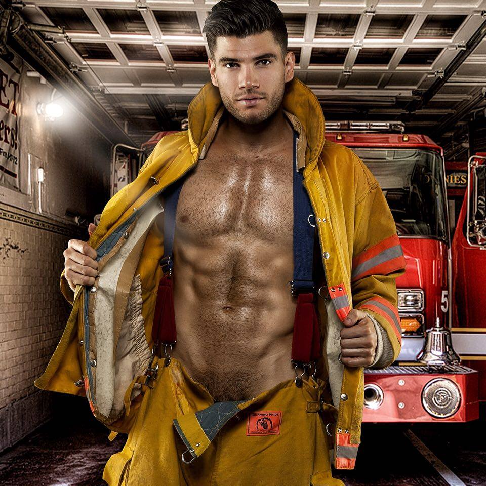 Male Stripper Wearing a fireman jacked with the front Open